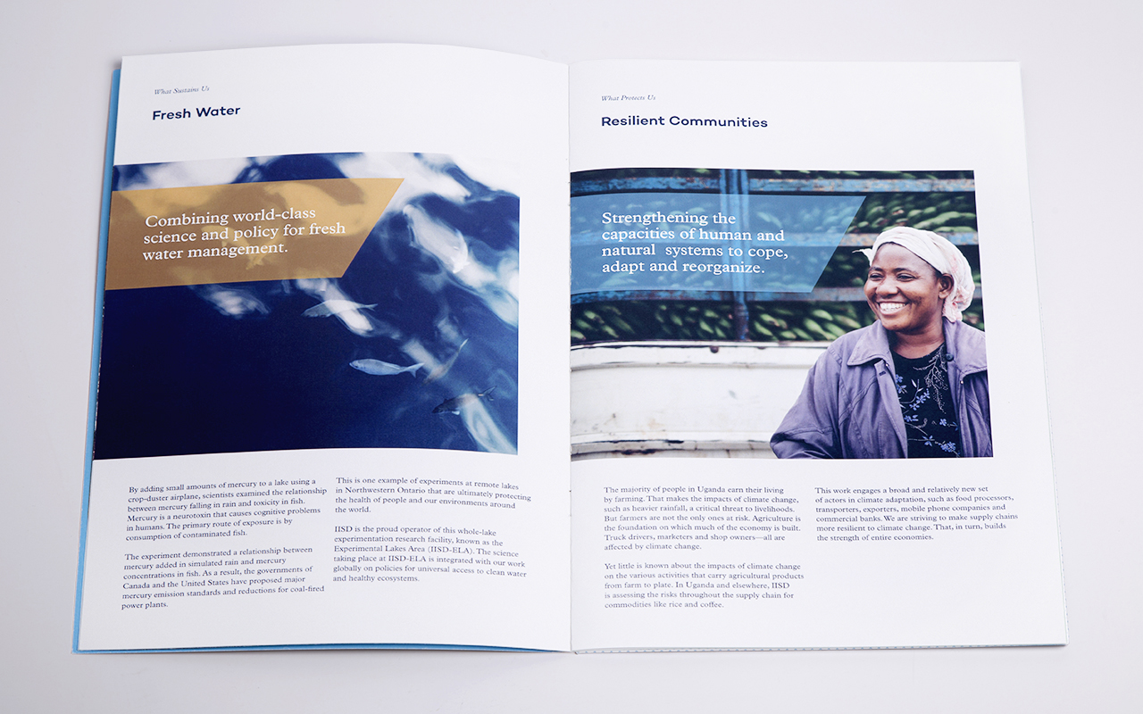 Inside spread of a printed annual report that shows two examples of what sustains us including Fresh Water and Resilient Communities.
