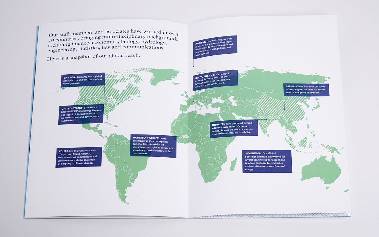 Inside spread of a printed annual report that features a world map which includes annotations and descriptions that point to various locations that give a snapshot of the International Institute for Sustainable Development's global reach.