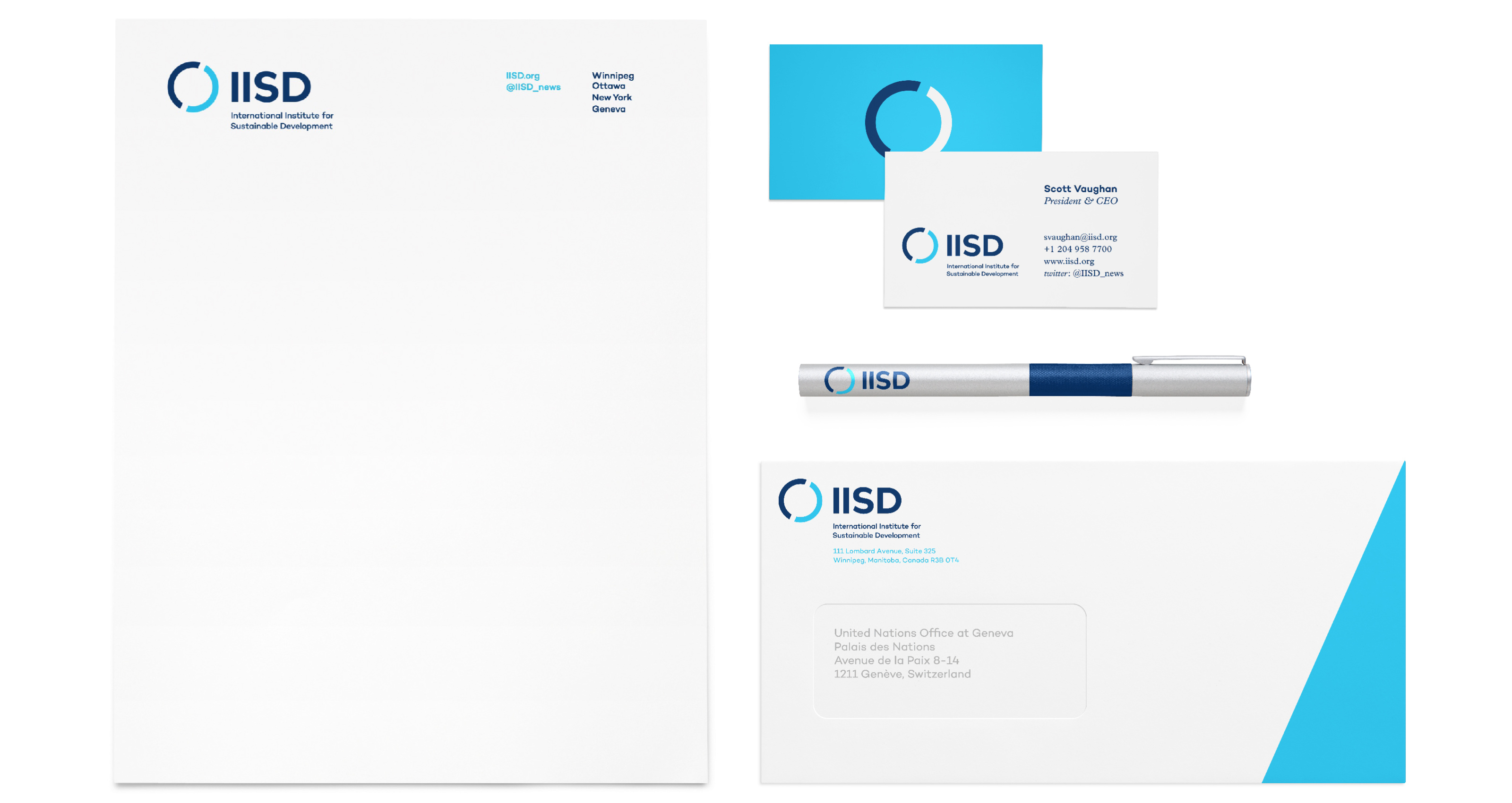 Examples of IISD's stationery brand applications. The IISD brand treatment is applied to a letterhead, business cards, a pen and an envelope.