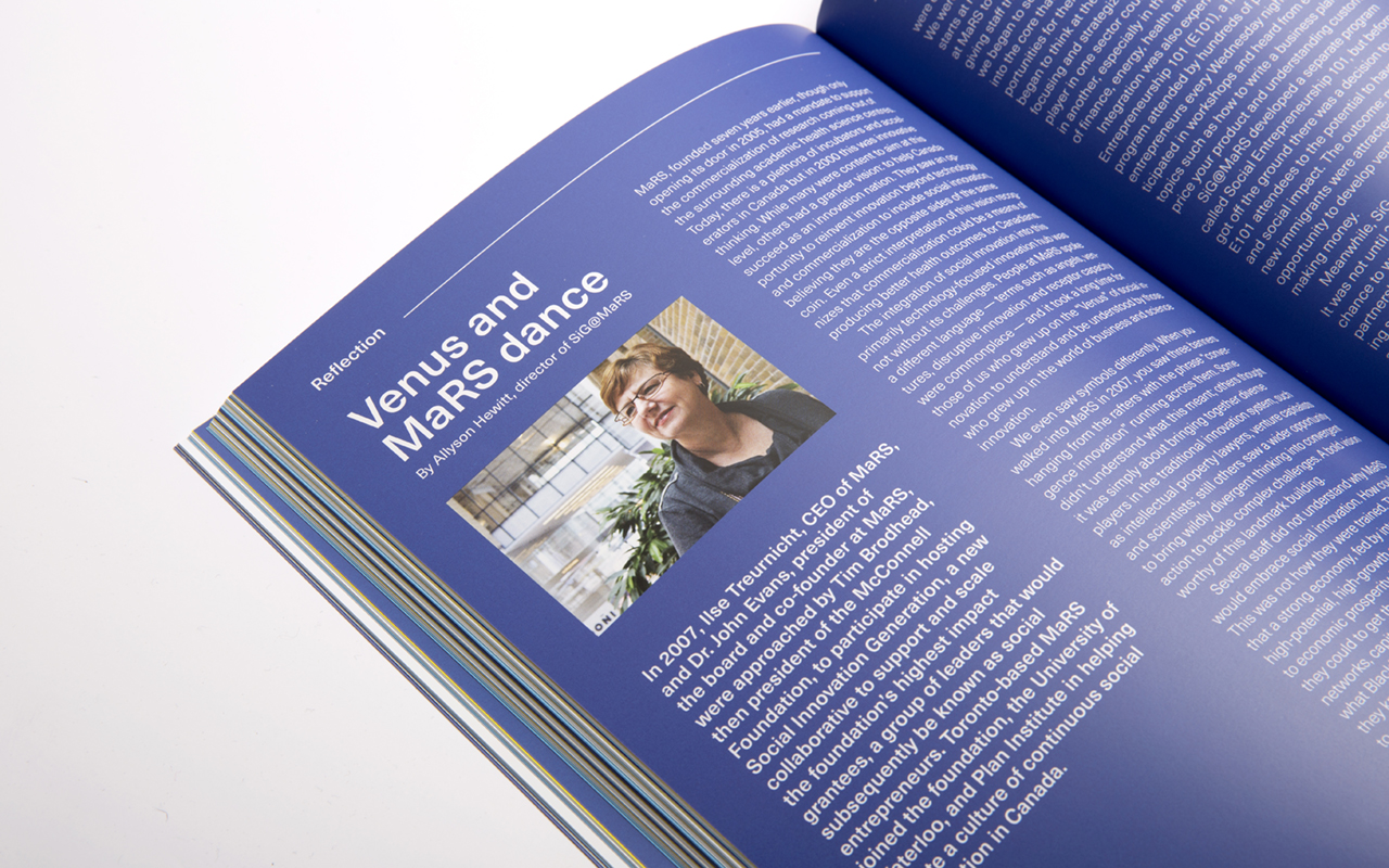 Close up of the book showing a reflection blue spread