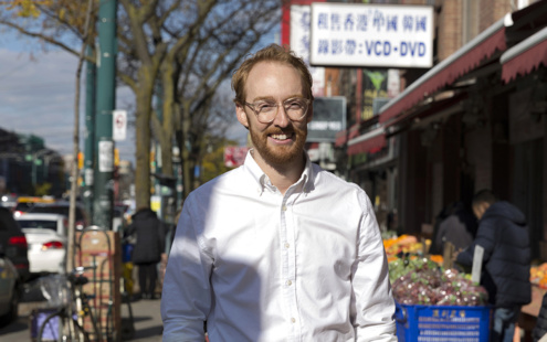 Close up of team member Fraser in front of a market in Chinatown.